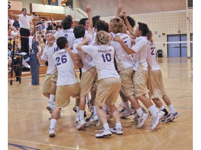 The Valencia boys volleyball team celebrates its victory in the CIF-Southern Section Division II championship match on May 31, 2003. The win gave Valencia High its first ever CIF crown.
