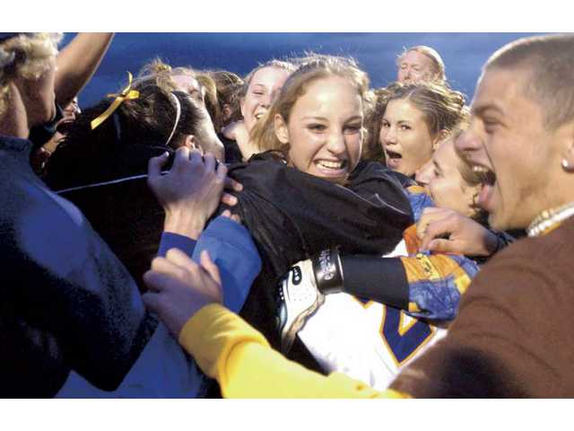 The Valencia High soccer team celebrates with goalkeeper Jaisa Creps, center, on March 4, 2003, after its victory over Brea Olinda in the CIF-SS Div. II semifinals.