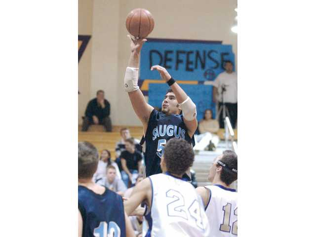 Saugus' BJ Willkomm goes up for two of his 26 points on Jan. 13, 2004, at Valencia High School. Willkomm broke the Saugus all-time points record during the game and finished with 1,261 total points at the end of the season.