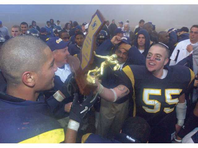 The College of the Canyons football team celebrates after its 39-32 victory over City College of San Francisco on Dec. 11, 2004, in the Mineral Bowl in Visalia. The win gave the Cougars the state and national championships.
