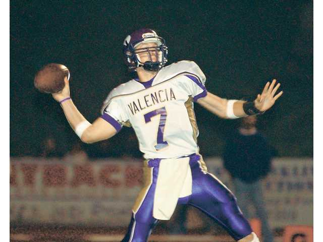 Valencia's Michael Herrick left the school as the state's all-time leader in passing yardage, attempts and completion.