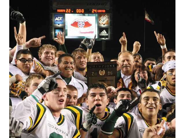 The 2006 CIF Division I State Champion Canyon High School football team raises the trophy it earned with a 27-13 win over De La Salle of Concorde on Dec. 16, 2006.