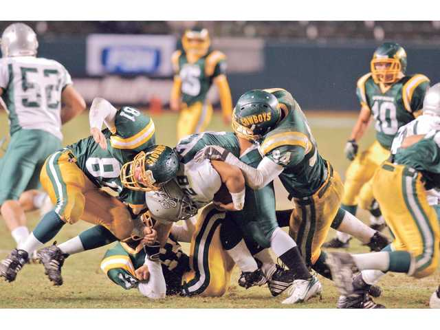 Canyon's Ben Armbruster (81)  and Michael Pyne (34) tackle De La Salle's Ryan Nastor (28) at the Home Depot Center on Dec. 16, 2006, in the Division I State Championship Game.