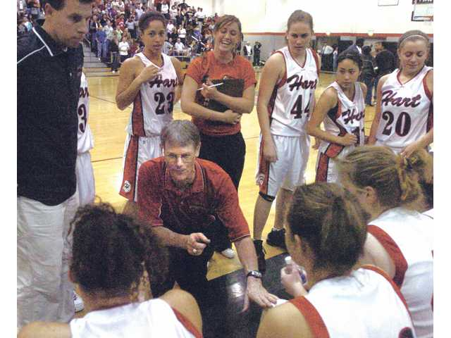 Hart girls basketball head coach Dave Munroe, center, won a 15th league title in his 18th year and final year with the program. The Indians reached the CIF Division I Southern California Regional semifinal.