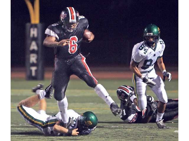 Hart High running back Delano Howell (6) leaps over a Moorpark player during their game in September of 2007. For the first time since 2003, the Indians reclaimed the Foothill League football throne, and advanced to the CIF-Southern Section Northern Division championship game.