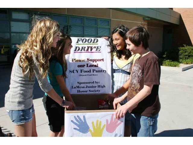 Members of the Honor Society at La Mesa Junior High are collecting food for the Santa Clarita Valley Food Pantry through Tuesday. From left are Kristie Moody, Andie Hill, Jordan Dulay and Dane Cannon.