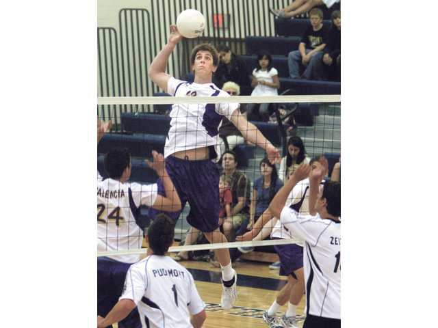 Valencia's Skyler Seymour (23) leaps to spike the ball against West Ranch during the 2008 season. The Vikings won their fourth CIF-Southern Section Division II championship and were named national champions after the season.