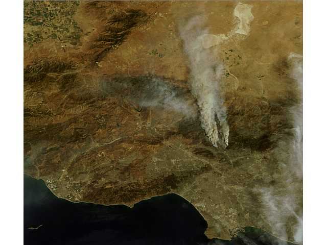 This Chelys satellite view caught the Station Fire as it grew Saturday.