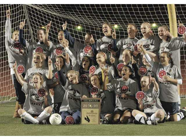The Saugus girls soccer team poses for a team photo after winning the CIF-SS Division II championship on March 6.