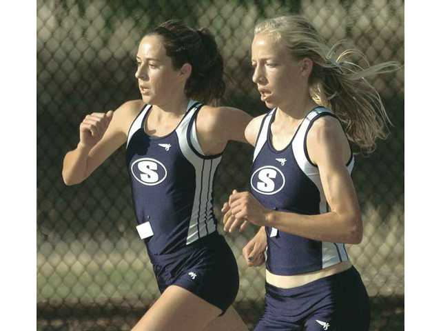 Thanks in part to Kaylin Mahoney, left, and Karis Frankian, Saugus won its record fourth straight CIF state cross country championship in 2009 and continued its dominance of California.