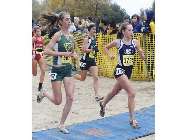 Saugus junior cross country runner Kaylin Mahoney, right, competes at the CIF State Division II championship meet at Woodward Park in Fresno in late November. Mahoney's third-place overall finish helped the Centurions win an unprecedented fourth consecutive CIF state championship.
