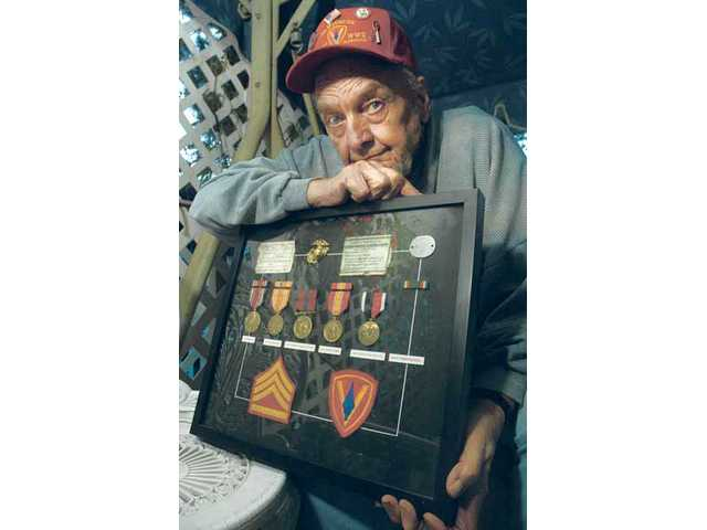 Carl Diekman, of Canyon Country, holds the medals and ribbons he earned during his service in two separate wars. The decorated veteran was one of 110,000 Marines who invaded Iwo Jima in the closing months of World War II. Diekman also served in the Korean War and helped train Marines at Camp Lejeune in North Carolina.