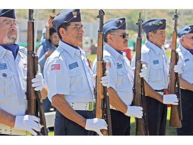 The All Veterans Burial Squad, from Sylmar, prepares for a rifle salute at the Memorial Day Tribute.