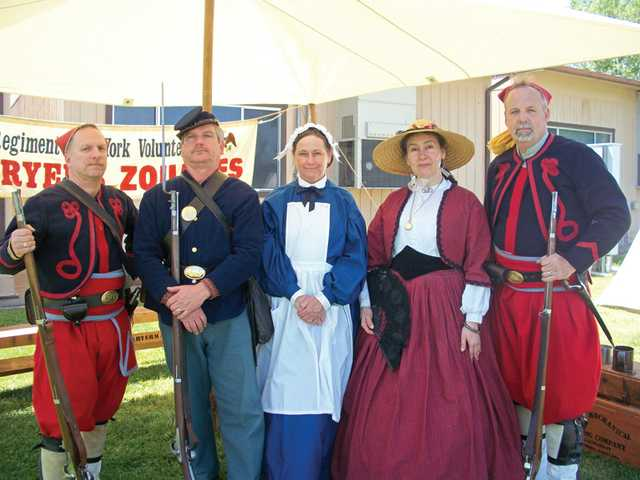 Members of the 5th New York Civil War Volunteer Infantry pose in their costumes during Placerita Junior High School's Civil War Day. Actors demonstrated techniques in marching, firing their weapons and hand-to-hand combat with bayonet and rifle hilts. Some were dressed in the uniform of the Zouaves infantry unit. Two women introduced students to the role of women in the Civil War, showing how the American Red Cross distributed care packages to soldiers and how women sent many important items that the army did not supply. Women even disguised themselves as men and fought in the war.