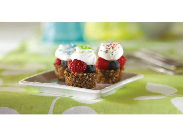 Itsy bitsy fruit piesPrep Time: 25 minutesTotal Time: 30 minutesServings: 241/2 cup butter or margarine1 cup milk chocolate morsels1/4 teaspoon cinnamon4 cups Kellogg's® Rice Krispies® cereal2 cups assorted fresh chopped fruitsFrozen non-dairy whipped topping, thawedAssorted sprinklesIn medium saucepan, melt butter over low heat. Stir in chocolate morsels until melted. Remove from heat. Stir in cinnamon. Place cereal in large bowl. Carefully pour melted chocolate mixture over cereal. Gently stir until cereal is completely coated with chocolate.Spoon cereal mixture into twenty-four 1 1/2-inch muffin-pan cups coated with cooking spray. Using your finger, press cereal mixture onto bottoms and up the sides of each cup, forming crusts.Place crusts in freezer for 30 minutes. Remove from freezer. Refrigerate, covered, until ready to serve.Before serving, fill each crust with fresh fruit. Dollop with whipped topping. Decorate with sprinkles. Serve immediately.Note: Extra unfilled crusts may be frozen in air-tight container for up to a month. Let stand at room temperature for 15 minutes before serving.