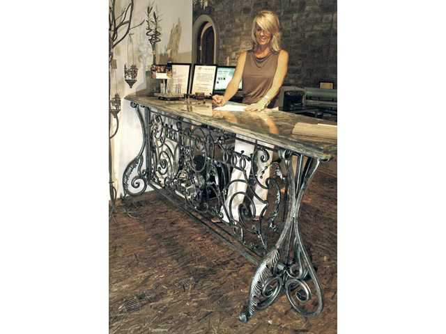 A custom wrought-iron and marble counter serves as the checkout for Stephanie Laney's shop, which also showcases her interior design work. The longtime Stevenson Ranch resident recently reopened the shop after a seven-year closure.