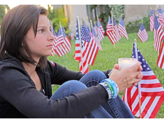 Castaic resident Kailee Pelino, 13, listens to speakers at the candlelight vigil for Marine Corps Pfc. Jake William Suter on Wednesday evening. Suter was killed in Afghanistan Saturday, May 29, 2010.