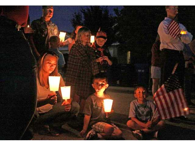 Locals mourn and support the family of Marine Corps Pfc. Jake William Suter in a candlelight vigil in Stevenson Ranch Wednesday night. Suter, 18, was killed in Afghanistan on Saturday, May 29, 2010.