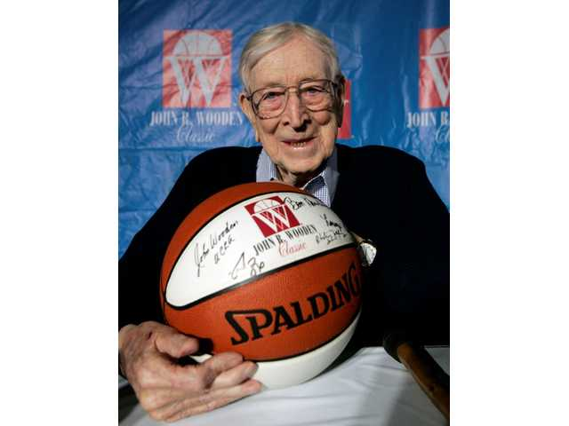 In this Dec. 9, 2005, file photo, former UCLA basketball coach John Wooden poses after a news conference in Anaheim, Calif., about Saturday's Wooden Classic basketball tournament. Wooden, college basketball's gentlemanly Wizard of Westwood who built one of the greatest dynasties in all of sports at UCLA, died June 4, 2010. He was 99.