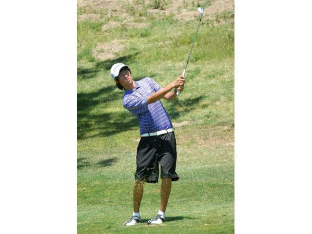 Valencia's Jonathan Chang watches his shot on the seventh hole Thursday at the CIF/SCGA Championship held at The Golf Club at Rancho California.  Chang shot a 2-over 74 but did not advance to the CIF State Championship.