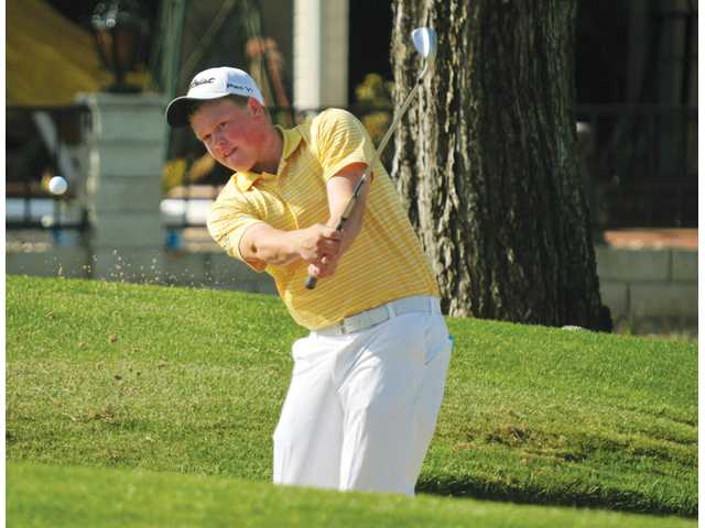 West Ranch junior J.J. Holen chips out of a bunker on the 16th hole at The Golf Club at Rancho California in Murrieta on Thursday during the CIF/SCGA Southern California Golf Championship. Holen shot a 1-under 71 but did not advance to the CIF State Championship.