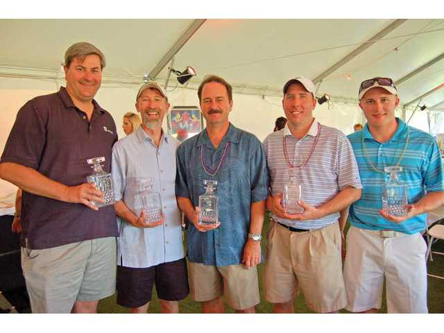 Left to right, the first-place net team of Henry Mayo Newhall Memorial Hospital's charity tournament included Steve Ortiz, Brett Byrd, Mark Savage, Mark Nikander and Kyle Smith.