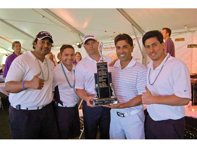 The tournament boasted its best ever attendance by physicians, with seven five-somes taking to the greens. From left to right, the team of Dewey Pillai, M.D., Jeff Bowne, D.C., Josh Mitchell, D.C., Tony Avakian, D.P.M. and Tom Piazza won the Perpetual Physician's trophy.