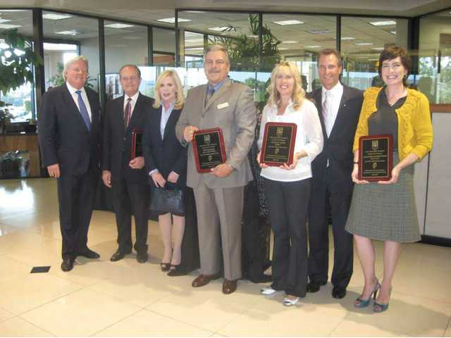 Among those honored were, left to right, Greg McWilliams, representing Newhall Land, Jack and Doreen Shine, Bill McClendon of Lexus of Valencia, Melina, and Michael Berger and Michele Mann, of Mehta and Mann. Not pictured are Wayne and Dianne Crawford, and Don and Cheri Fleming.