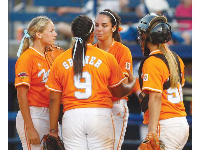Valencia High graduate Jessica Spigner (9) and Saugus graduate Tiffany Huff, right, talk with Tennessee teammates Ivy Renfroe, second from right, and Erinn Webb on Sunday in Oklahoma City. The Lady Vols were eliminated by Arizona, which will face UCLA in the Women's College World Series starting today.
