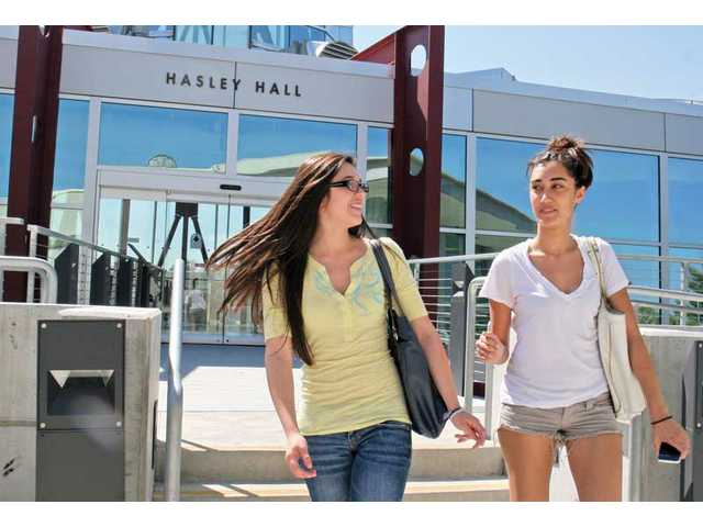 Janette Alcaraz, left,  and Mary Sabry walk out from Hasley Hall  during their first day of summer school at College of the Canyons. Summer sessions began Monday and go until Aug. 14. Sabry is taking six units, and Alcaraz is taking eight units.