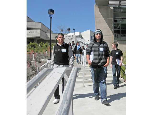 "From left to right, Bowman High School students Gustavo Ramirez, Carlos Vargas and Mikis Constantine walk through the College of the Canyons campus as part of ""Cougar Days."""