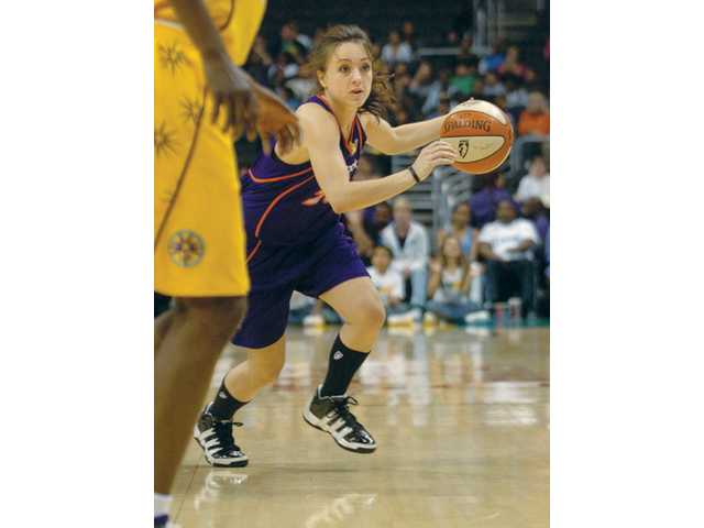 Hart High graduate Taylor Lilley, center, dribbles during the first half as a member of the Phoenix Mercury on Tuesday against the Los Angeles Sparks at the Staples Center.