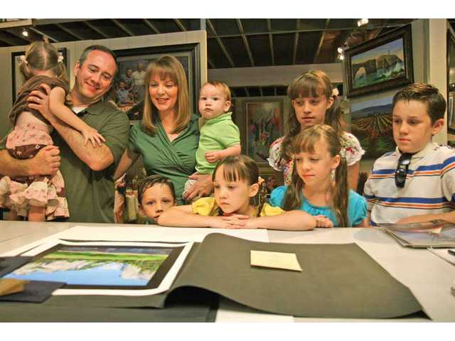 The Matthews family looks over artwork ready to be framed at B & R Gallery.