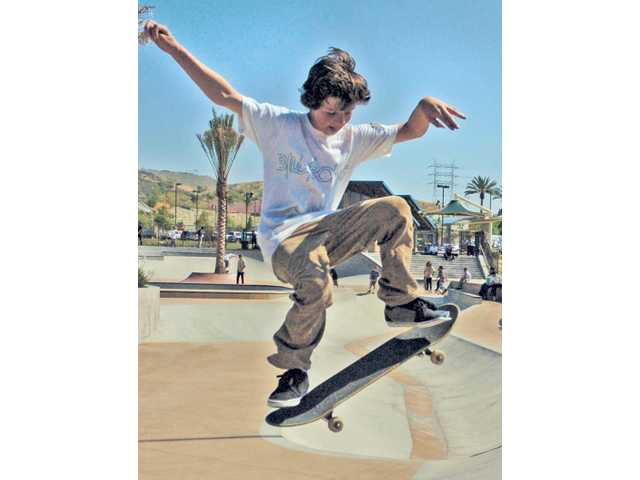 "Local skater Tyler Pacheco, 13, competes in the Pro-Am division of the Volcom ""Wild in the Parks"" skate competition at Santa Clarita Skatepark on Saturday."