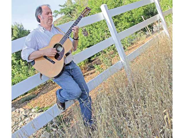 Local teacher and former monk Tom Renaud's new album, 'Walk Till Morning,' features songs he's written over the last 20 years.