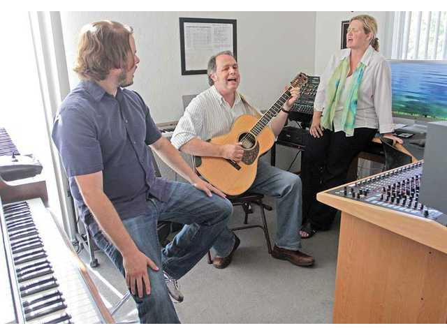 "Producer Steven Leavitt, musician Tom Renaud and Renaud's wife Lee Kurimoto sing in Leavitt's studio. Renaud, who lived his life as a monk for 25 years, left to pursue his singing and teaching careers. He has a new album, ""Walk Till Morning."""