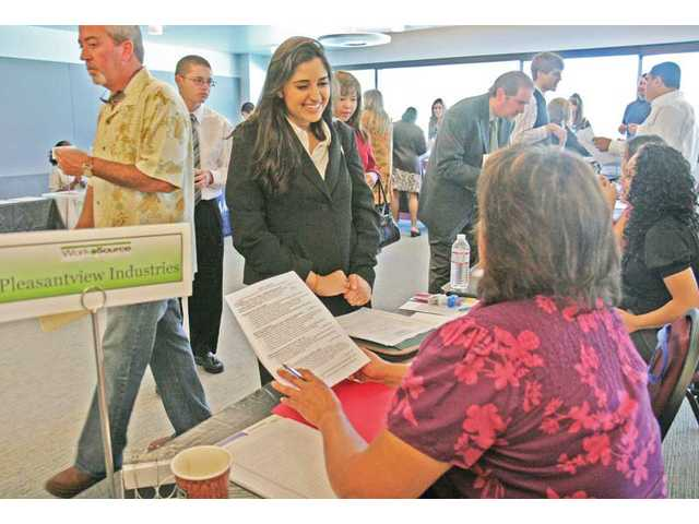 Komal Tejwani, of Valencia, talks with Jennifer Zimmerman of Pleasantview Industries Inc., after handing Zimmerman her resume at the job fair sponsored by the Santa Clarita WorkSource Center in the College of the Canyons University Center on Friday. Tejwani is a recent California State University, Northridge graduate and is seeking for a job in the field of social services.