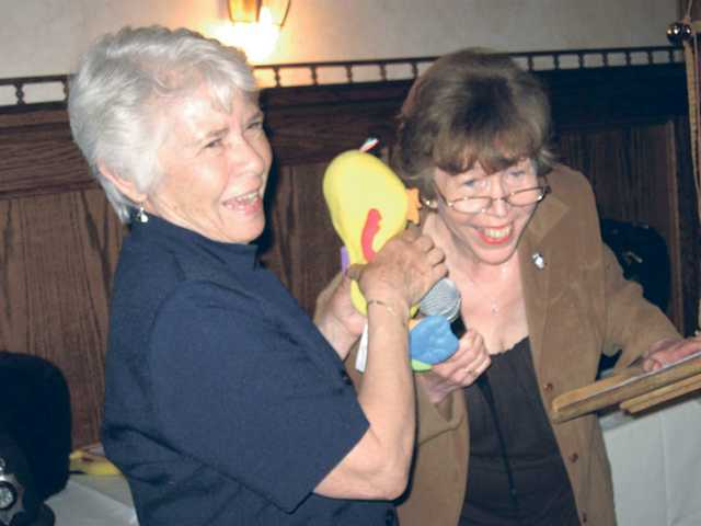 "Karla Edwards is encouraged to ""keep paddling"" by installing officer City Councilwoman Marsha McLean who presented Edwards with a toy duck."