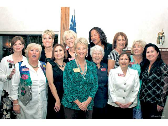Members of the 2010-11 Zonta Club of SCV board pose with Dianne Curtis, center, president-elect of Zonta International and a past president of the Zonta Club of Santa Clarita Valley. Front, left to right, Chris Miller, secretary; Bernie Gilbert, treasurer; Curtis; Karla Edwards, president; Alicia Estrada, first vice president-programs; and Edna Dimataga-Fernandez, board member. Second row  Cindy Kittle, past president; and directors Diane Goddard, Barbara Stearns-Cochran, JoAnne Lindsey, Adele Macpherson; and JoAnn Rodriguez, president-elect.