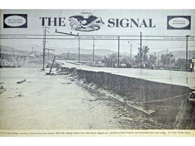 Above is a photo of the front page of The Signal newspaper from the January 27, 1969 issue, showing part of Soledad Canyon Road washed away by the Santa Clara River, which had swelled due to heavy rains. The statewide damage totaled over $400 million.