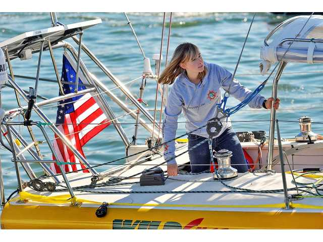 In a, Jan 23, 2010 file photo, Abby Sunderland, 16, looks out from her sailboat, Wild Eyes, as she leaves for her world record attempting journey at the Del Rey Yacht Club in Marina del Rey, Calif.