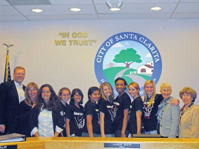 Students from the Human Rights Watch Student Task Force poses with the Santa Clarita City Council. The young human rights advocates furthered their activism on April 27 at City Hall, where they asked the City Council to adopt the Convention on the Rights of the Child as a symbolic declaration to lead the community in the protection and promotion of children's rights.