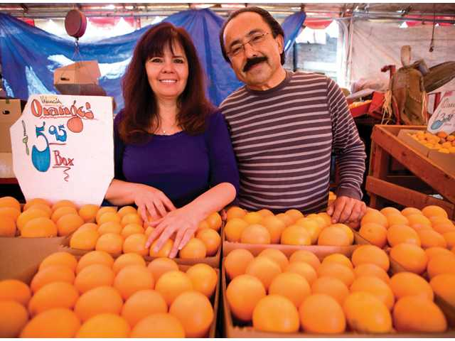 Francesca and Francisco Cardenas, owners of Francisco's Fruits, which has been in business for more than 25 years.