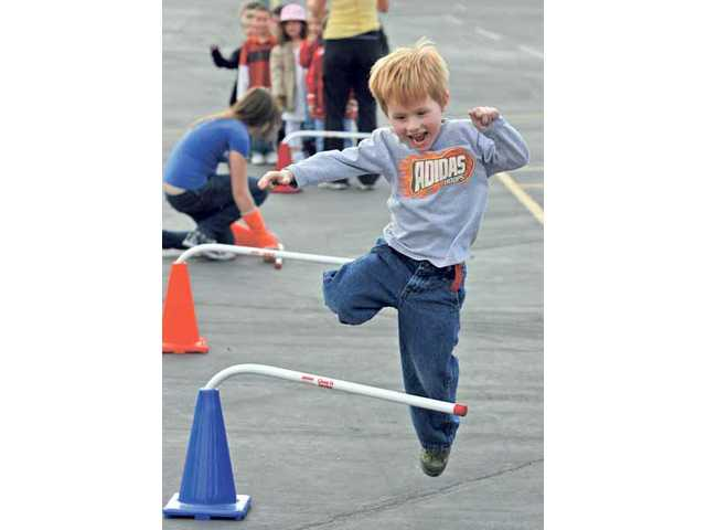 Meadows Elementary kindergartner Nigel Shirley jumps a hurdle as part of a triathlon staged at the Valencia school back in February as part of a fundraiser for the American Heart Association.