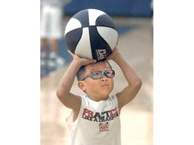 Noah Neri, 6, sets up for a free-throw attempt during free play at The Master's College Basketball Camp on Tuesday.