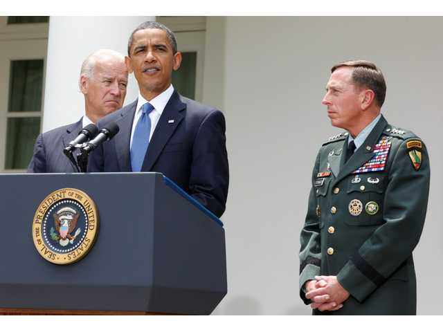 President Barack Obama stands with Gen. David Petraeus and Vice President Joe Biden in the Rose Garden of the White House in Washington, Wednesday, June 23, 2010, to announce that Petraeus will replace Gen. Stanley McChrystal.