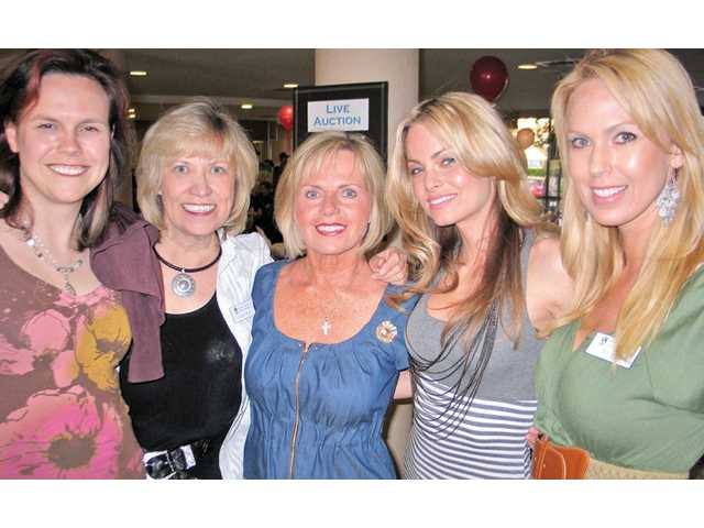 Cheri Fleming, second from right, is the Soroptimist International of the Americas Camino Real Region Governor. She is joined by Soroptimist International of SCV President Donna Kreutz and other Soroptimist members at the poker fundraiser held at the Courtyard Marriott in Valencia. The event raised nearly $10,000 to assist women and girls.