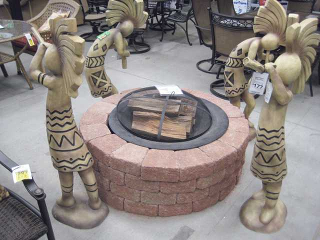 Metal fire pit, $89, with stacked bricks,$152.