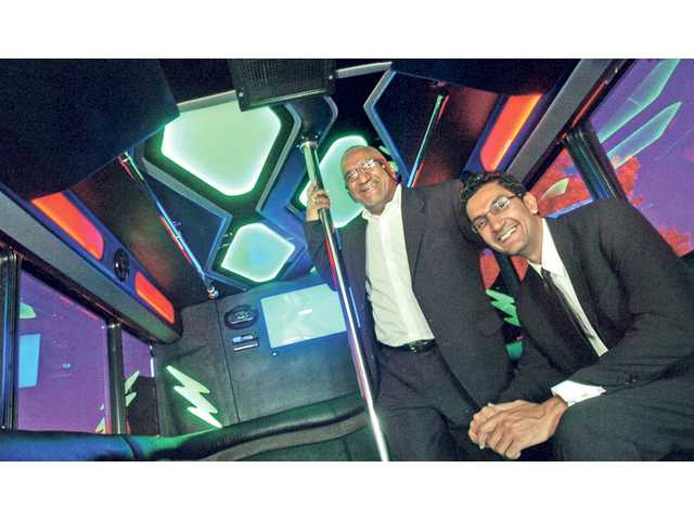 The Bali men inside the company's 35-passenger party bus, which features long, cushioned seating, flashing lights and a booming stereo system. Natives of India, Kuldip started the company and Vin is the vice president.