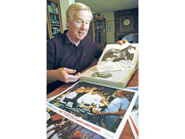 Michael McGreevey looks through old photo albums containing photos from his extensive career as a child and young adult actor.